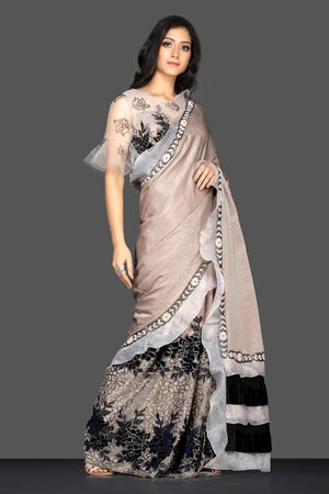 Buy cream embroidered sari online in USA with designer saree blouse. Keep your ethnic fashion on point with exquisite designer saris, partywear saris, embroidered sarees from Pure Elegance Indian fashion boutique in USA.-side