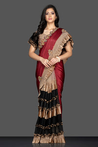 Buy maroon and black designer saree in USA with golden ruffles and designer saree blouse. Elevate your sartorial choice with exclusive Indian designer sarees with blouse, embroidered sarees, party sarees from Pure Elegance Indian fashion store in USA.-full view