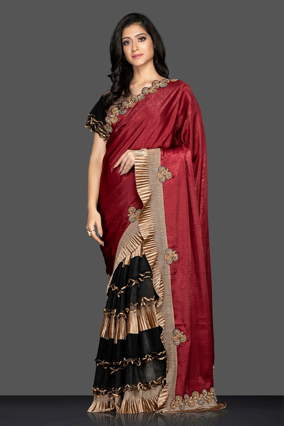 Buy maroon and black designer saree in USA with golden ruffles and designer saree blouse. Elevate your sartorial choice with exclusive Indian designer sarees with blouse, embroidered sarees, party sarees from Pure Elegance Indian fashion store in USA.-side