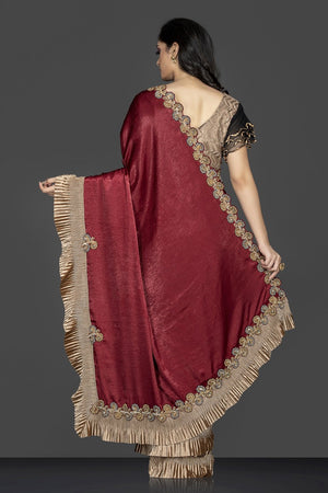 Buy maroon and black designer saree in USA with golden ruffles and designer saree blouse. Elevate your sartorial choice with exclusive Indian designer sarees with blouse, embroidered sarees, party sarees from Pure Elegance Indian fashion store in USA.-back