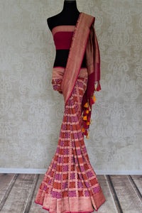 Shop beautiful magenta zari check georgette Banarasi saree online in USA. Go for an extraordinary traditional look with splendid handwoven sarees, embroidered sarees with blouses, Banarasi saris from Pure Elegance from Indian cloth store in USA.  Shop online or visit our store now.-full view