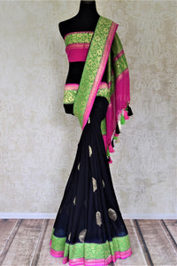 Shop gorgeous black organza Banarasi sari online in USA with green foliate zari border and zari buta. Make your saree wardrobe rich and colorful with stunning handwoven sarees, pure silk sarees, designer sarees from Pure Elegance Indian clothing store in USA.-full view