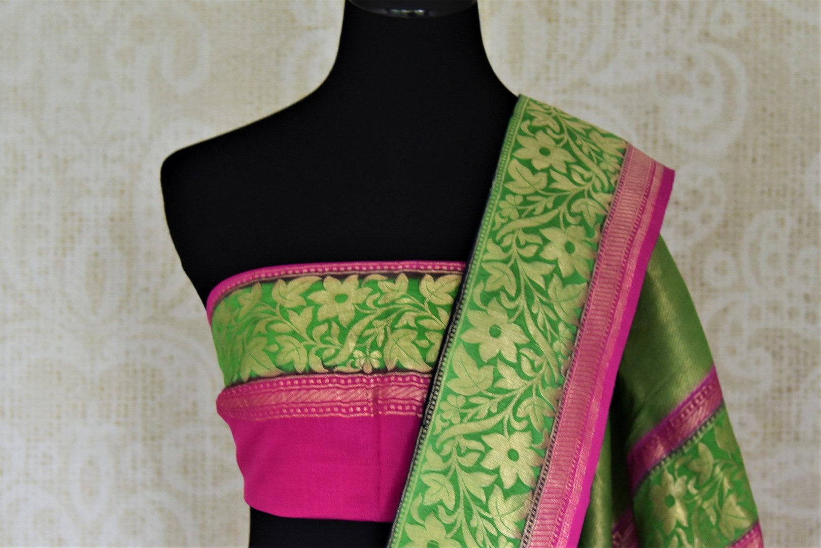 Shop gorgeous black organza Banarasi sari online in USA with green foliate zari border and zari buta. Make your saree wardrobe rich and colorful with stunning handwoven sarees, pure silk sarees, designer sarees from Pure Elegance Indian clothing store in USA.-blouse pallu