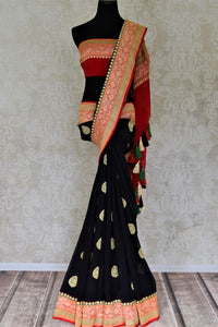 Buy captivating black floral zari buta georgette Banarasi saree online in USA. Go for an extraordinary traditional look with splendid handwoven sarees, embroidered sarees with blouses, Banarasi saris from Pure Elegance from Indian cloth store in USA.  Shop online or visit our store now.-full view