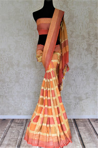 Buy lovely orange and pink zari check georgette Banarasi sari online in USA. Go for an extraordinary traditional look with splendid handwoven sarees, embroidered sarees with blouses, Banarasi saris from Pure Elegance from Indian cloth store in USA.  Shop online or visit our store now.-full view