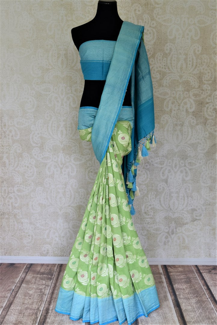 Shop light green muga Benarasi saree online in USA with blue zari border and marigold buta. Make your saree wardrobe rich and colorful with stunning handwoven sarees, pure silk sarees, designer sarees from Pure Elegance Indian clothing store in USA.-full view