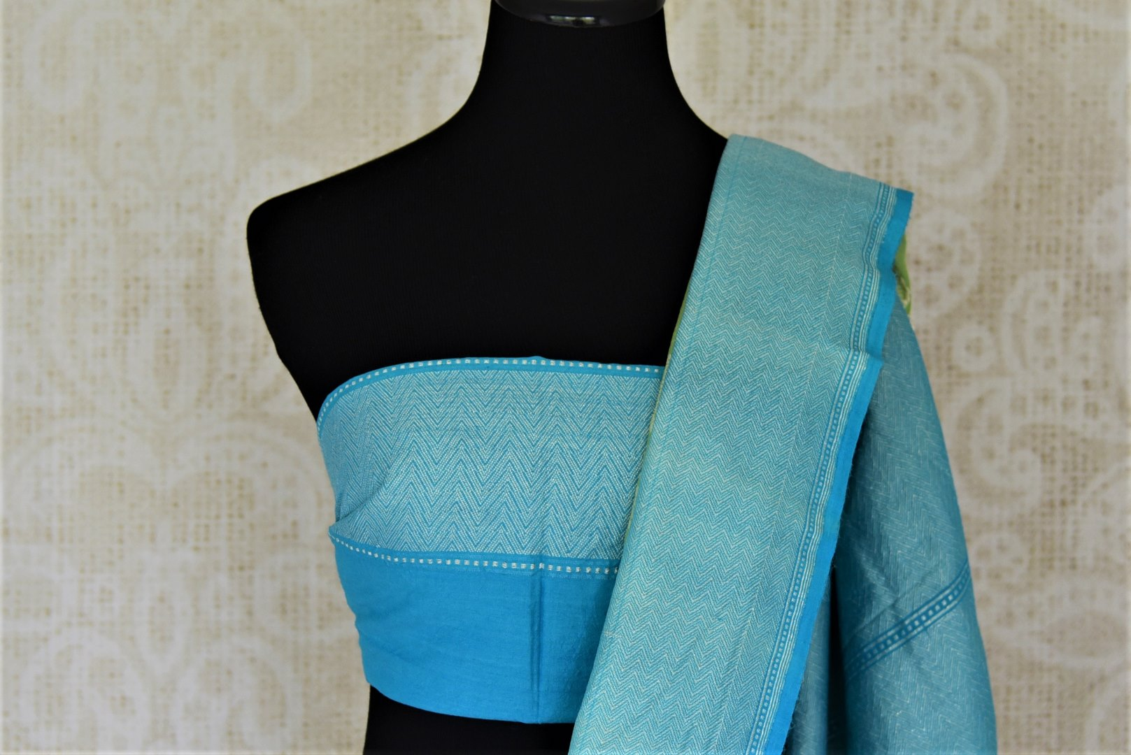 Shop light green muga Benarasi saree online in USA with blue zari border and marigold buta. Make your saree wardrobe rich and colorful with stunning handwoven sarees, pure silk sarees, designer sarees from Pure Elegance Indian clothing store in USA.-blouse pallu