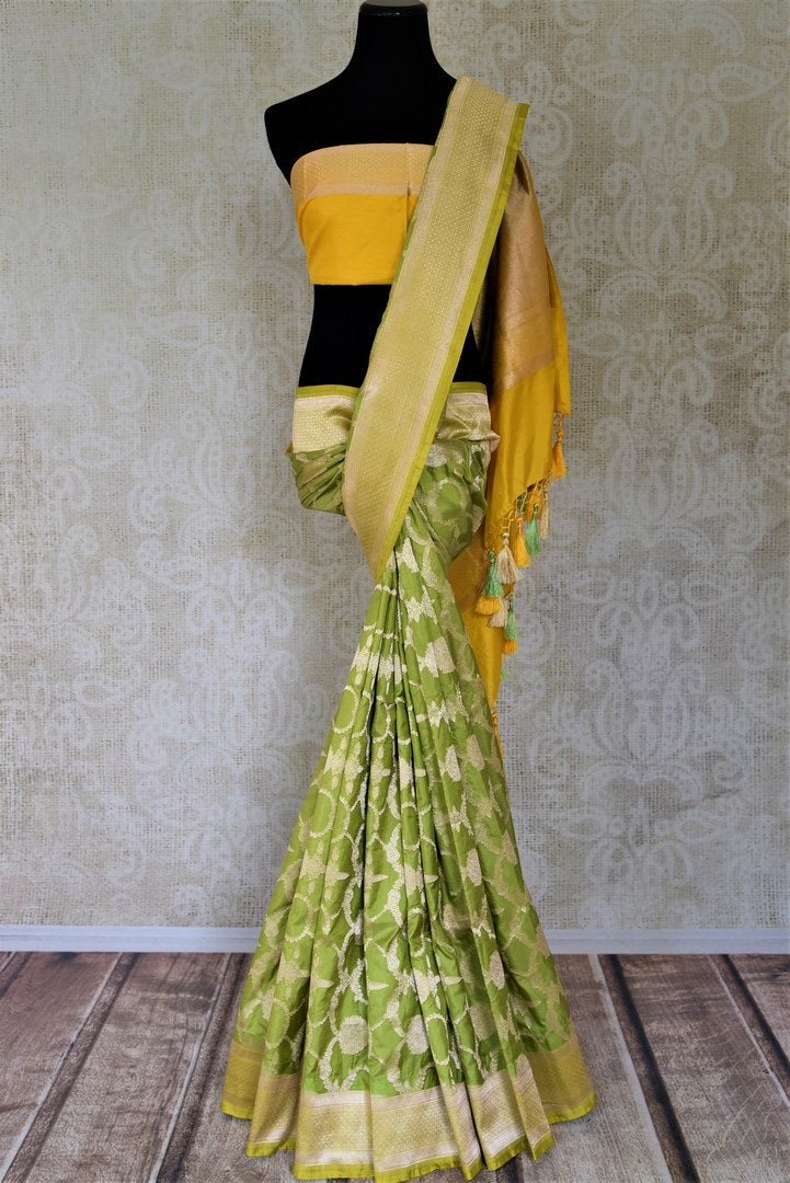 Buy pistachio green Benarasi silk saree online in USA with yellow zari border. Make your saree wardrobe rich and colorful with stunning handwoven sarees, pure silk sarees, designer sarees from Pure Elegance Indian clothing store in USA.-full view