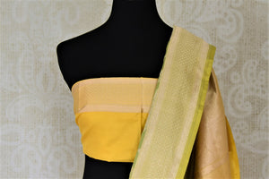 Buy pistachio green Benarasi silk saree online in USA with yellow zari border. Make your saree wardrobe rich and colorful with stunning handwoven sarees, pure silk sarees, designer sarees from Pure Elegance Indian clothing store in USA.-blouse pallu