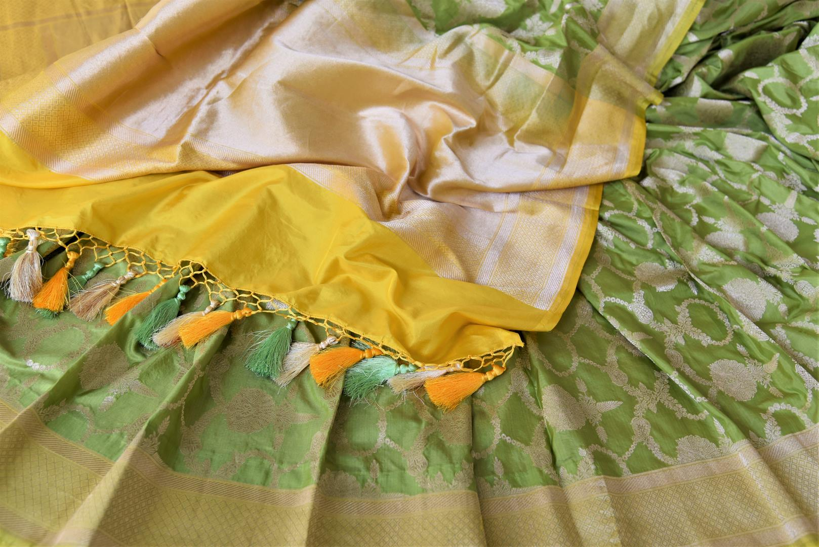 Buy pistachio green Benarasi silk saree online in USA with yellow zari border. Make your saree wardrobe rich and colorful with stunning handwoven sarees, pure silk sarees, designer sarees from Pure Elegance Indian clothing store in USA.-details