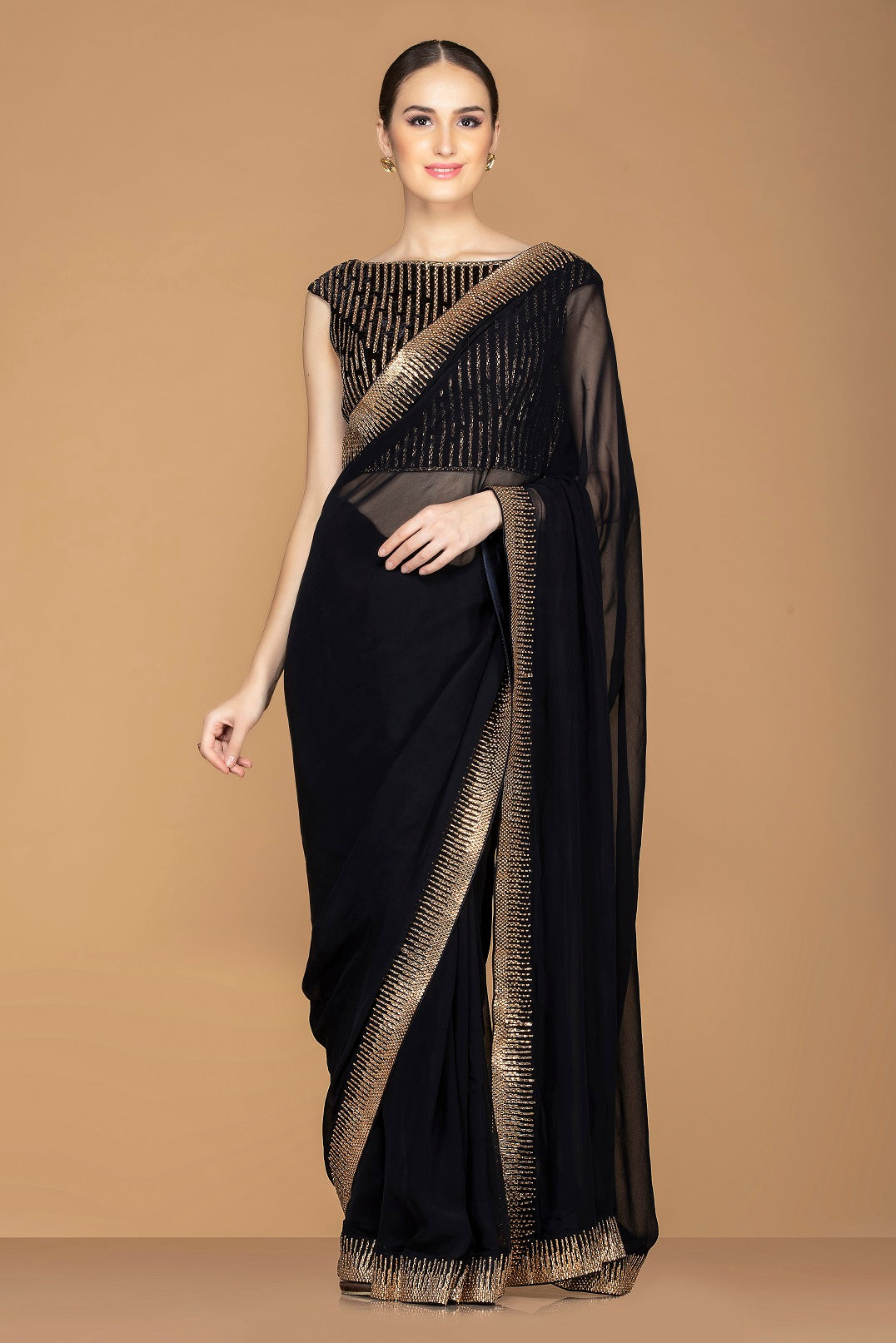 Buy ravishing black designer embroidered saree online in USA with black embroidered saree blouse. Champion ethnic fashion with a splendid collection of designer sarees, embroidered sarees with blouse, weddings sarees from Pure Elegance Indian fashion store in USA.-full view