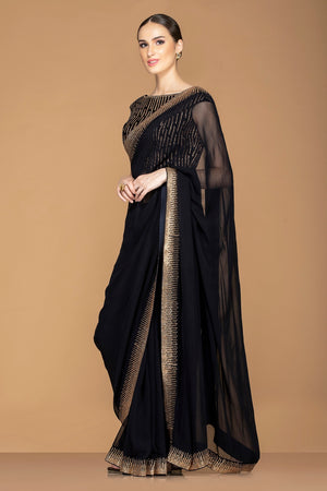 Buy ravishing black designer embroidered saree online in USA with black embroidered saree blouse. Champion ethnic fashion with a splendid collection of designer sarees, embroidered sarees with blouse, weddings sarees from Pure Elegance Indian fashion store in USA.-side