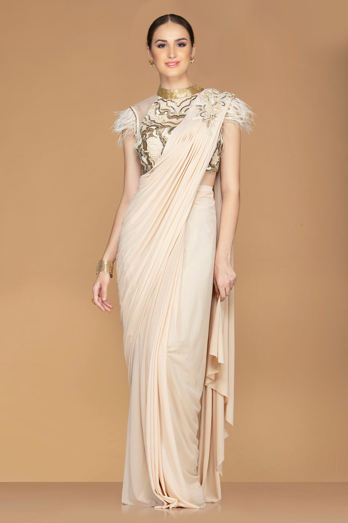 Shop stunning cream draped pallu saree online in USA with embroidered fancy sari blouse. Champion ethnic fashion with a splendid collection of designer sarees, embroidered sarees with blouse, weddings sarees from Pure Elegance Indian fashion store in USA.-full view