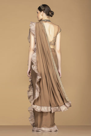 Buy elegant brown ruffle saree online in USA with embroidered designer sari blouse. Champion ethnic fashion with a splendid collection of designer sarees, embroidered sarees with blouse, weddings sarees from Pure Elegance Indian fashion store in USA.-back