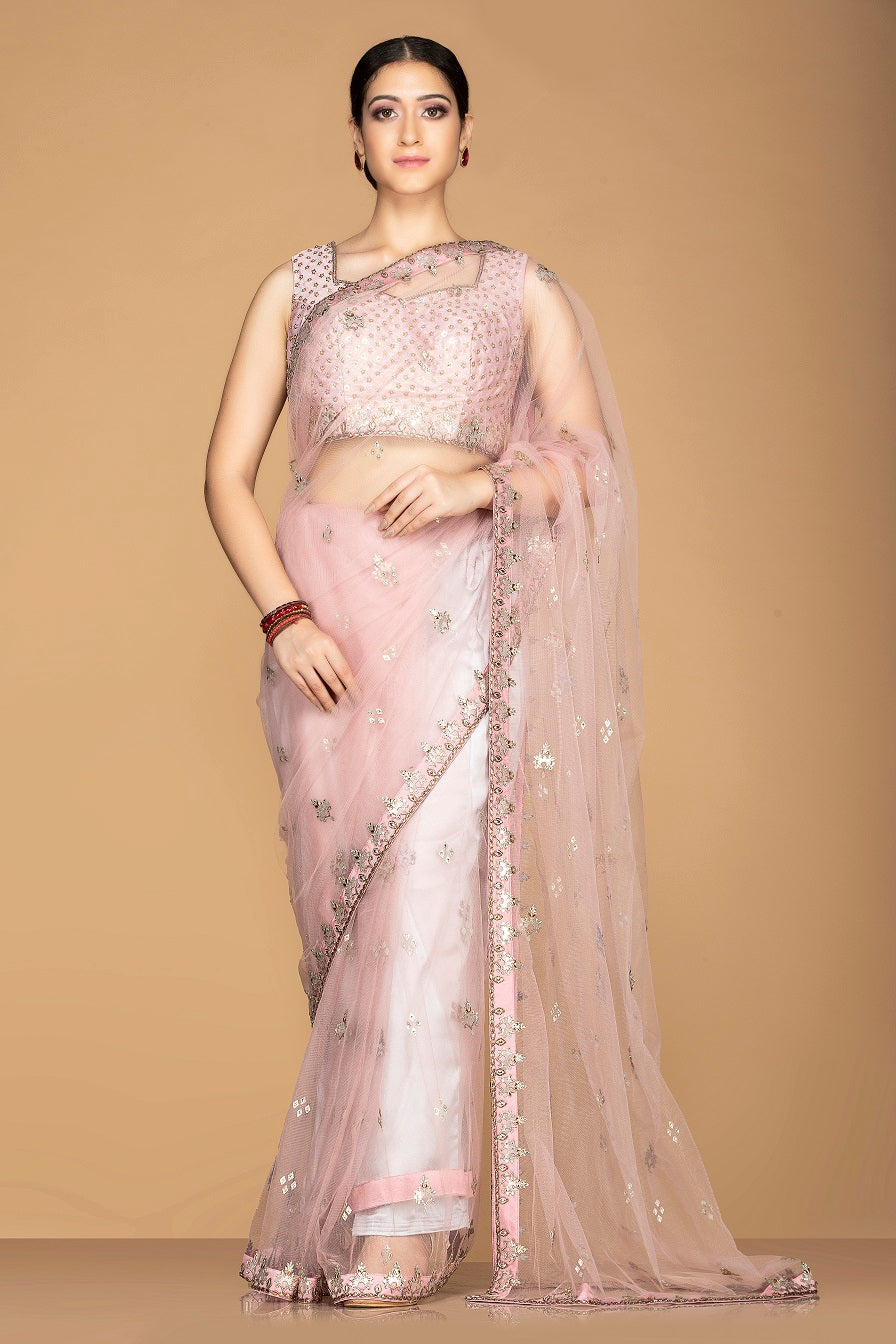 Shop stunning powder pink embroidered sheer saree online in USA with designer saree blouse. Champion ethnic fashion with a splendid collection of designer sarees, embroidered sarees with blouse, weddings sarees from Pure Elegance Indian fashion store in USA.-full view