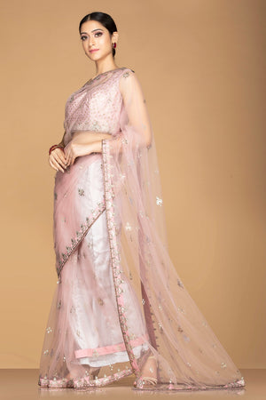 Shop stunning powder pink embroidered sheer saree online in USA with designer saree blouse. Champion ethnic fashion with a splendid collection of designer sarees, embroidered sarees with blouse, weddings sarees from Pure Elegance Indian fashion store in USA.-side