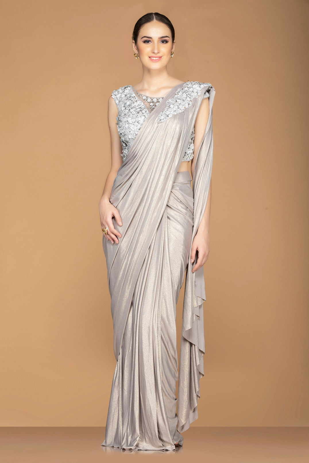 Shop stunning metallic grey draped pallu designer saree online in USA with embroidered sleeveless saree blouse. Champion ethnic fashion with a splendid collection of designer sarees, embroidered sarees with blouse, weddings sarees from Pure Elegance Indian fashion store in USA.-full view