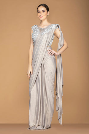 Shop stunning metallic grey draped pallu designer saree online in USA with embroidered sleeveless saree blouse. Champion ethnic fashion with a splendid collection of designer sarees, embroidered sarees with blouse, weddings sarees from Pure Elegance Indian fashion store in USA.-side