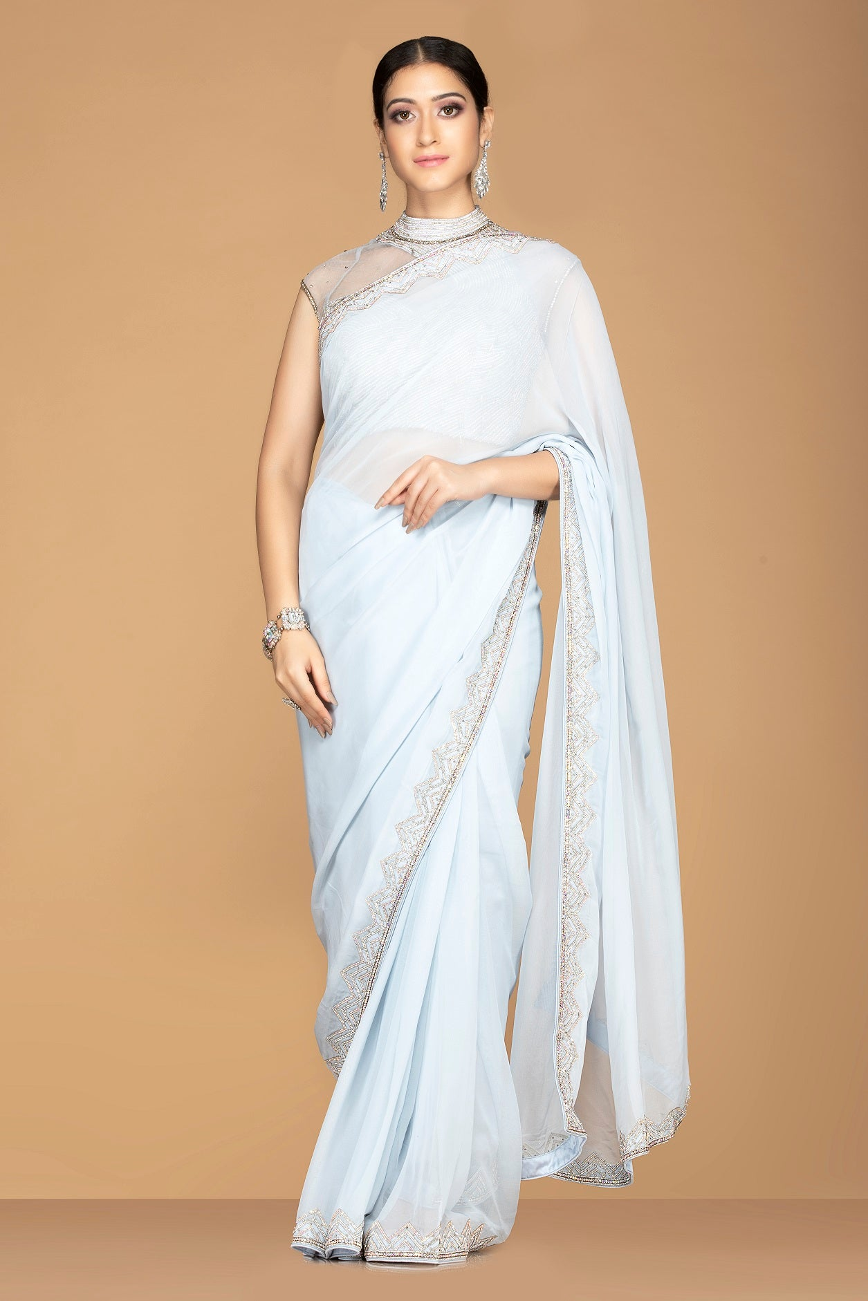 Shop charming powder blue embroidered sari online in USA with high neck saree blouse. Champion ethnic fashion with a splendid collection of designer sarees, embroidered sarees with blouse, weddings sarees from Pure Elegance Indian fashion store in USA.-full view
