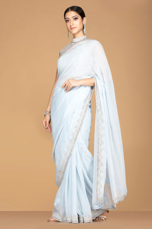 Shop charming powder blue embroidered sari online in USA with high neck saree blouse. Champion ethnic fashion with a splendid collection of designer sarees, embroidered sarees with blouse, weddings sarees from Pure Elegance Indian fashion store in USA.-side