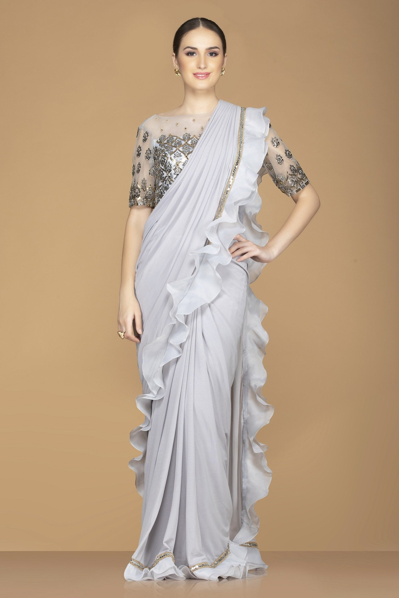 Buy beautiful light grey ruffle border saree online in USA with embroidered sari blouse. Champion ethnic fashion with a splendid collection of designer sarees, embroidered sarees with blouse, weddings saris from Pure Elegance Indian fashion store in USA.-full view