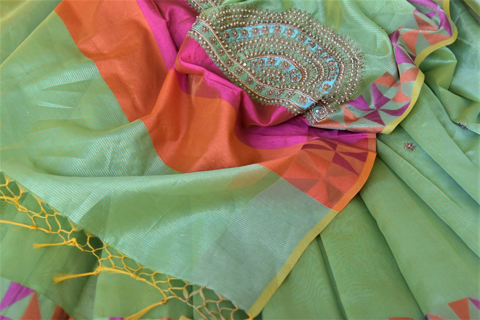 Stunning light green embroidered handloom saree for online shopping in USA with colorful border. Buy exquisite handloom sarees, pure silk sarees from Pure Elegance Indian clothing store in USA for festive occasions.-details