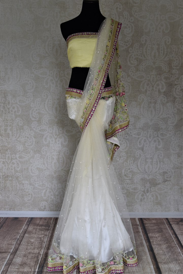 Alluring off-white embroidered designer net saree for online shopping in USA. Buy exquisite embroidered designer sarees with blouse from Pure Elegance Indian clothing store in USA for parties and festive occasions.-full view