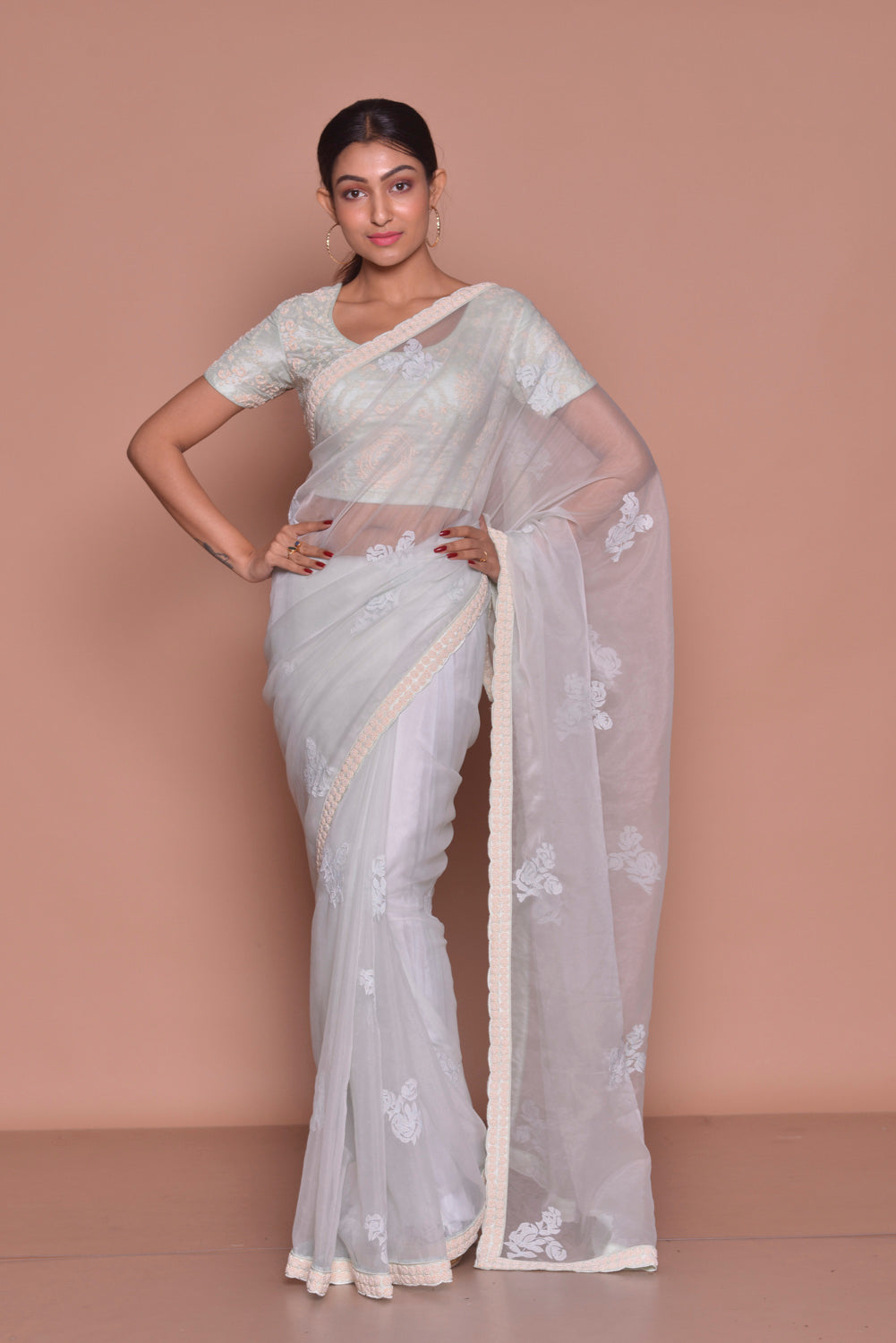 Buy stunning white embroidered sheer saree online in USA with embroidered sari blouse. Be occasion ready with exquisite range of designer sarees with blouse, bridal sarees from Pure Elegance Indian boutique in USA.-full view