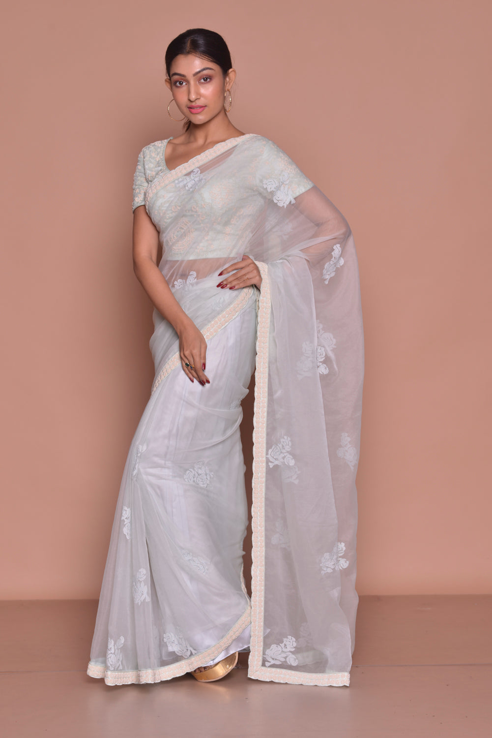 Buy stunning white embroidered sheer saree online in USA with embroidered sari blouse. Be occasion ready with exquisite range of designer sarees with blouse, bridal sarees from Pure Elegance Indian boutique in USA.-side