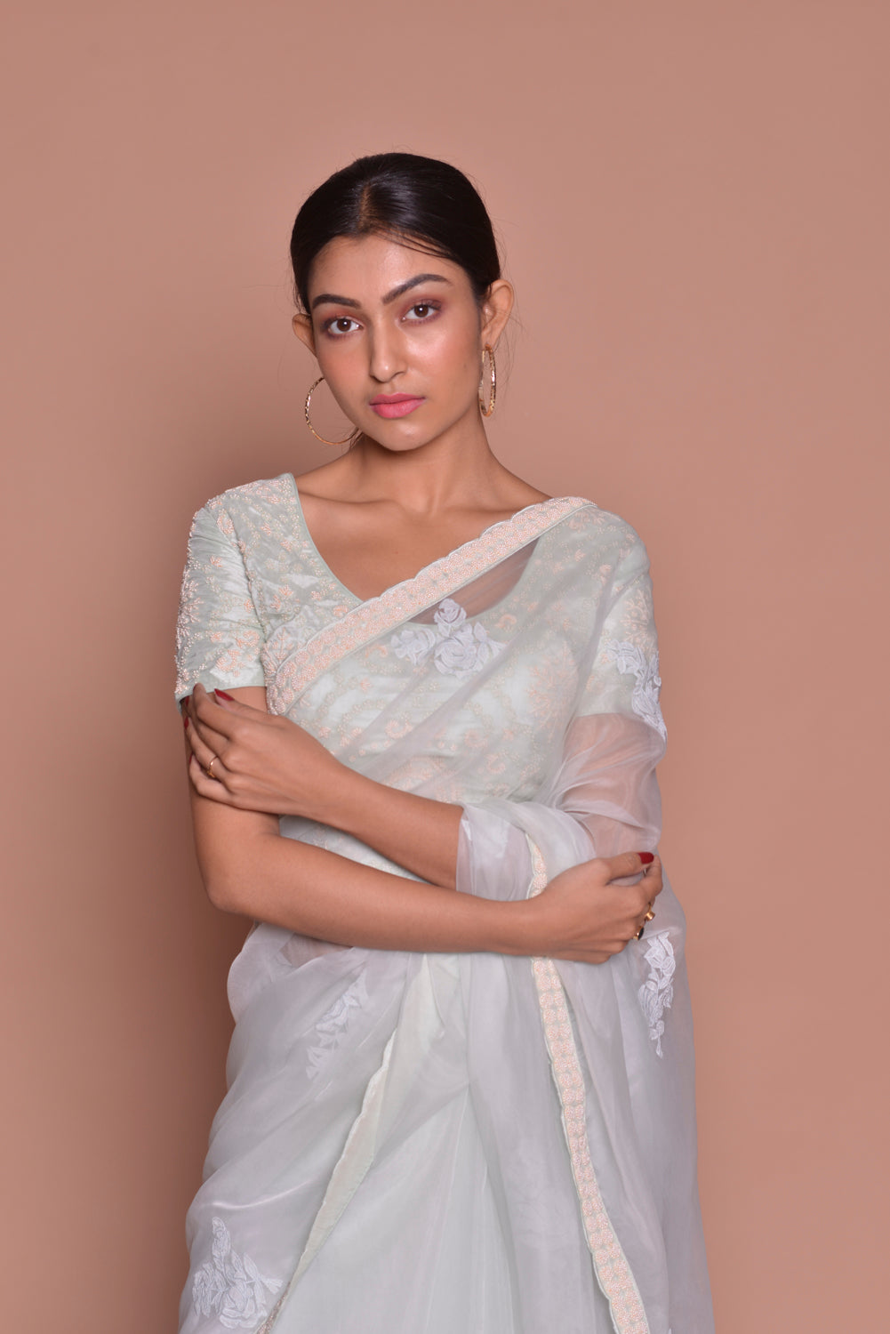 Buy stunning white embroidered sheer saree online in USA with embroidered sari blouse. Be occasion ready with exquisite range of designer sarees with blouse, bridal sarees from Pure Elegance Indian boutique in USA.-closeup