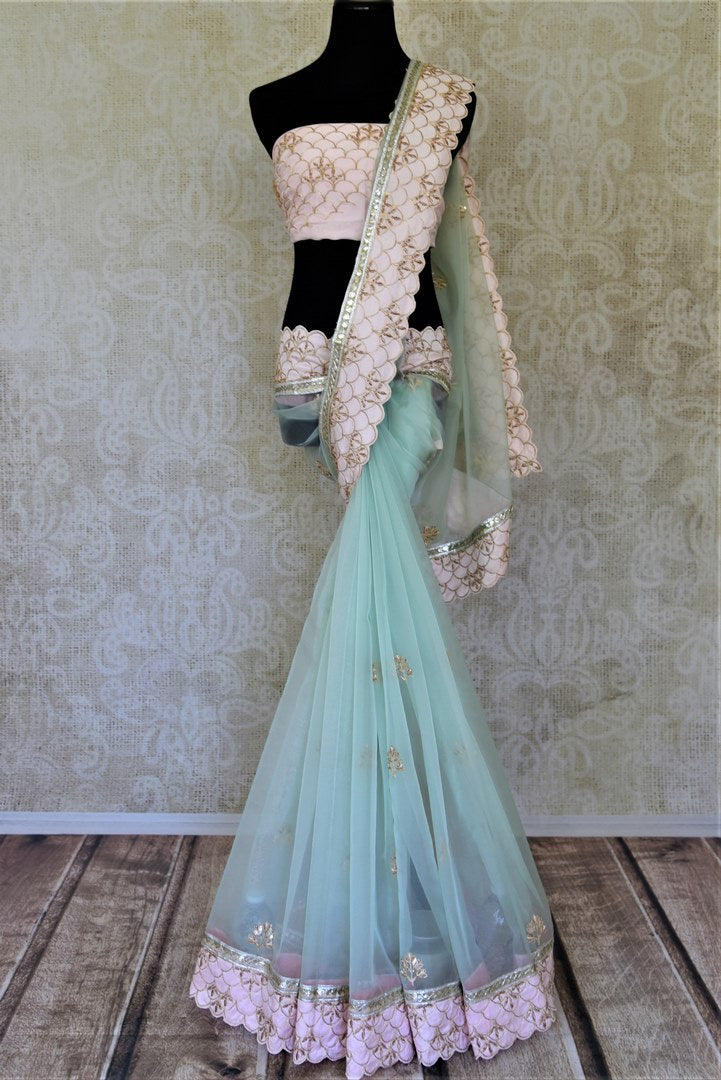 Shop mint green hand embroidered organza sari online in USA. Enhance your traditional saree style at weddings and festive occasions with designer sarees with blouse, pure silk sarees, handloom sarees  from Pure Elegance Indian clothing store in USA.-full view