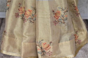 Stunning golden and grey embroidered handloom sari for online shopping in USA. Buy exquisite handloom saris with blouse from Pure Elegance Indian clothing store in USA for parties and festive occasions.-pleats