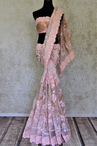 Buy beautiful baby pink hand embroidered organza saree online in USA. Enhance your traditional style at weddings and festive occasions with beautifully curated collection of embroidered sarees, pure silk sarees, designer saris from Pure Elegance Indian clothing store in USA.-full view