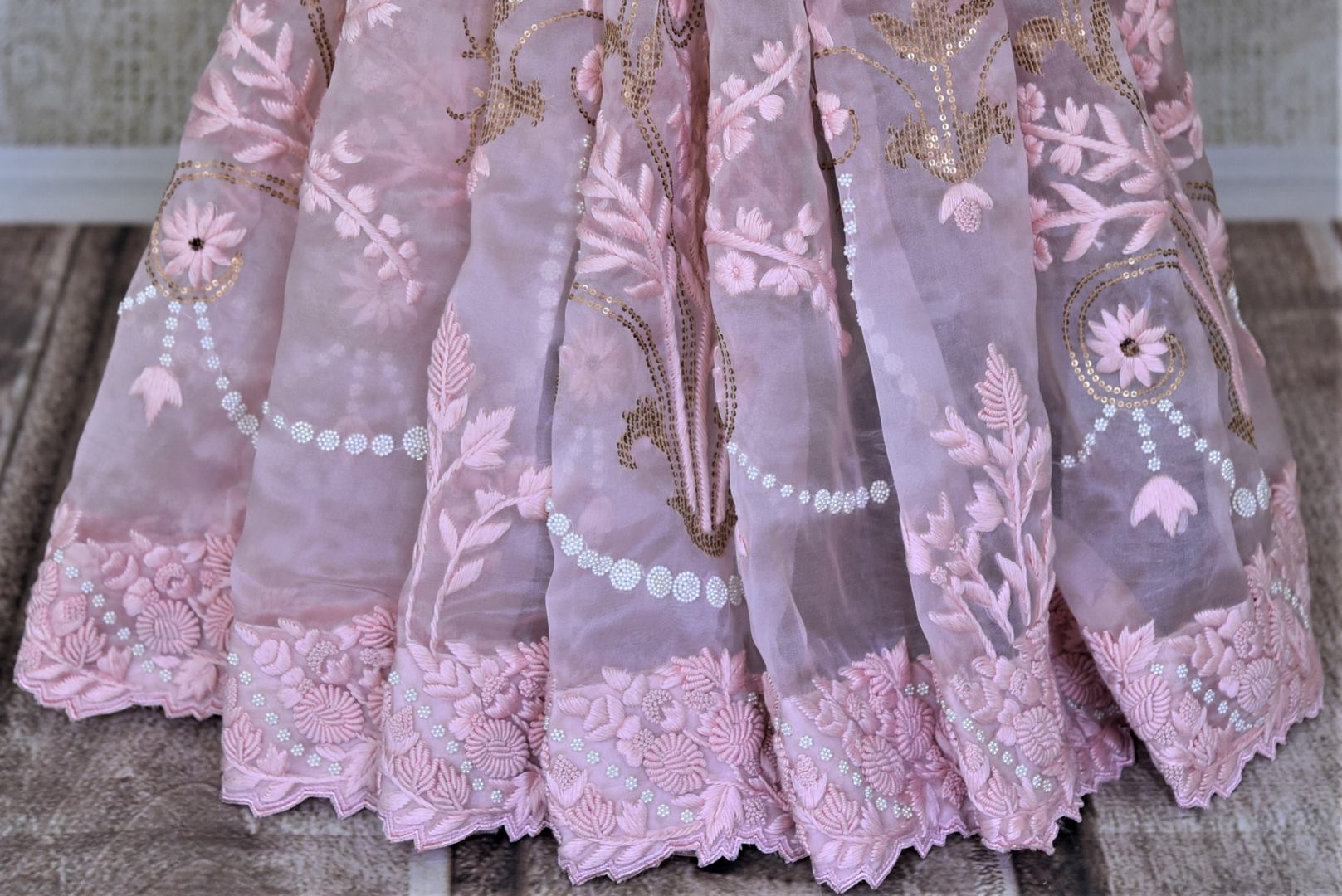 Buy beautiful baby pink hand embroidered organza saree online in USA. Enhance your traditional style at weddings and festive occasions with beautifully curated collection of embroidered sarees, pure silk sarees, designer saris from Pure Elegance Indian clothing store in USA.-pleats