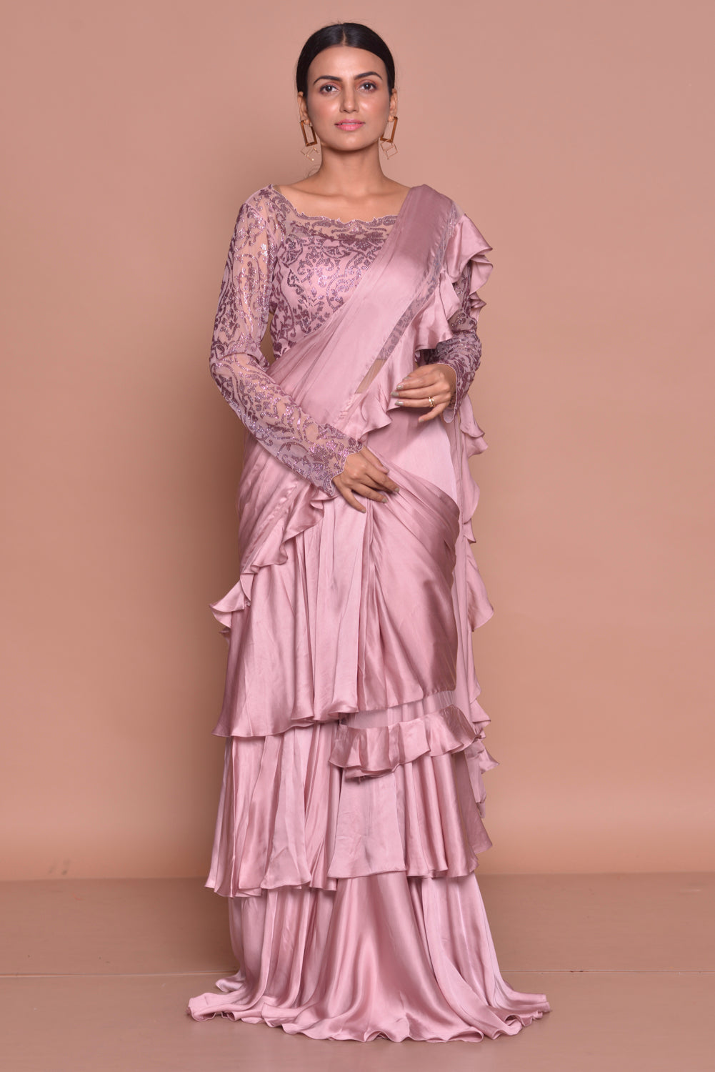 Buy stylish onion pink ruffled saree online in USA with full sleeves blouse. Look fashionable on special occasions in contemporary sarees, designer sarees with blouse, embroidered saris from Pure Elegance Indian luxury clothing store in USA.-full view