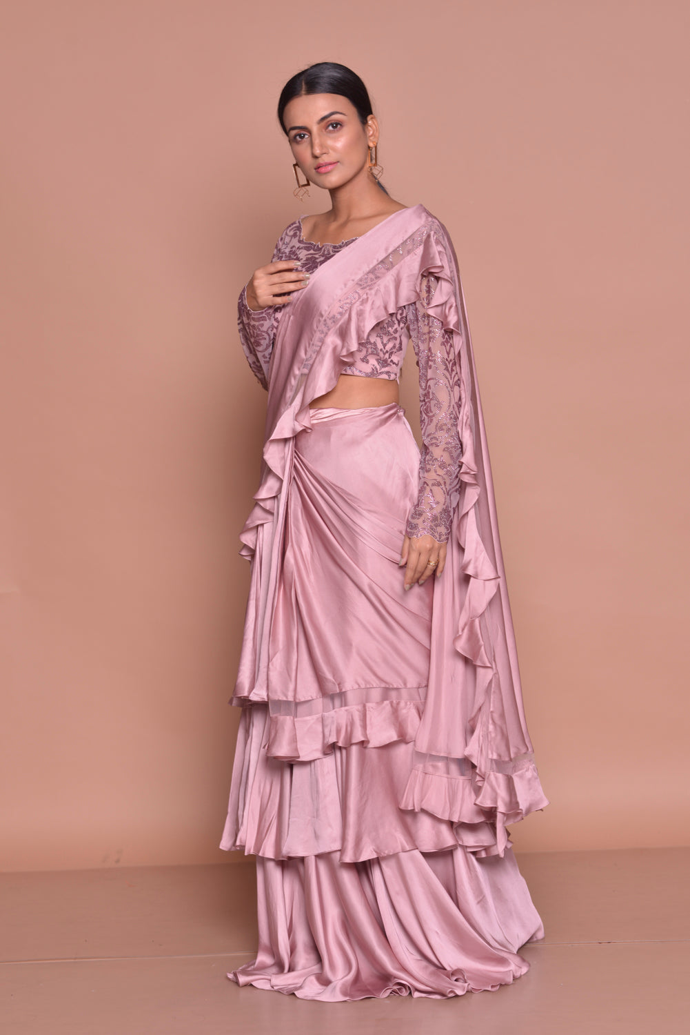 Buy stylish onion pink ruffled saree online in USA with full sleeves blouse. Look fashionable on special occasions in contemporary sarees, designer sarees with blouse, embroidered saris from Pure Elegance Indian luxury clothing store in USA.-side