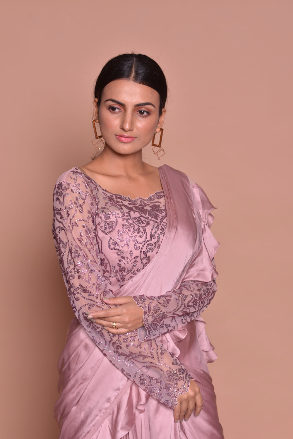 Buy stylish onion pink ruffled saree online in USA with full sleeves blouse. Look fashionable on special occasions in contemporary sarees, designer sarees with blouse, embroidered saris from Pure Elegance Indian luxury clothing store in USA.-closeup