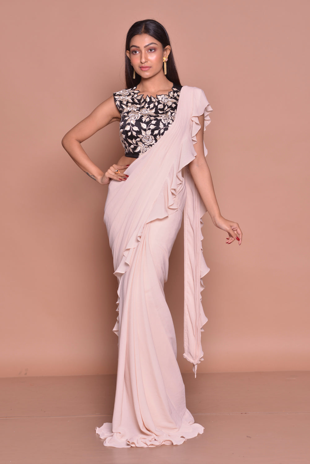 Shop cream ruffled saree online in USA with black embroidered saree blouse. Look fashionable on special occasions in contemporary sarees, designer sarees with blouse, embroidered saris from Pure Elegance Indian luxury clothing store in USA.-full view