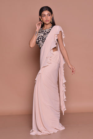 Shop cream ruffled saree online in USA with black embroidered saree blouse. Look fashionable on special occasions in contemporary sarees, designer sarees with blouse, embroidered saris from Pure Elegance Indian luxury clothing store in USA.-side