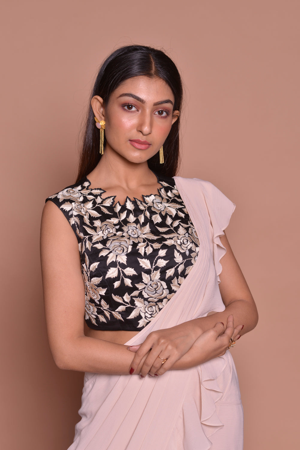 Shop cream ruffled saree online in USA with black embroidered saree blouse. Look fashionable on special occasions in contemporary sarees, designer sarees with blouse, embroidered saris from Pure Elegance Indian luxury clothing store in USA.-closeup