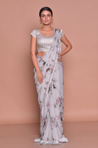 Shop lovely grey floral crepe saree online in USA with sleeveless sari blouse. Look fashionable on special occasions in contemporary sarees, designer sarees with blouse, embroidered saris from Pure Elegance Indian luxury clothing store in USA.-full view