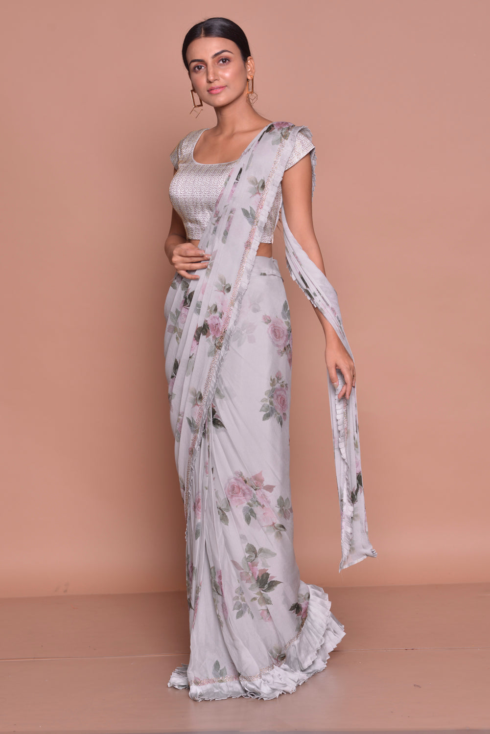 Shop lovely grey floral crepe saree online in USA with sleeveless sari blouse. Look fashionable on special occasions in contemporary sarees, designer sarees with blouse, embroidered saris from Pure Elegance Indian luxury clothing store in USA.-side