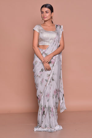Shop lovely grey floral crepe saree online in USA with sleeveless sari blouse. Look fashionable on special occasions in contemporary sarees, designer sarees with blouse, embroidered saris from Pure Elegance Indian luxury clothing store in USA.-front