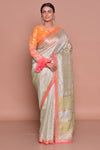 Buy stunning mint green linen Banarasi saree online in USA with orange embroidered saree blouse. Look fashionable on special occasions in contemporary sarees, designer sarees with blouse, embroidered saris from Pure Elegance Indian luxury clothing store in USA.-full view