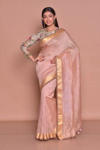 Shop elegant dusty pink saree online in USA with zari border and printed and embroidered blouse. Be occasion ready with exquisite range of designer sarees with blouse, bridal sarees from Pure Elegance Indian boutique in USA.-full view