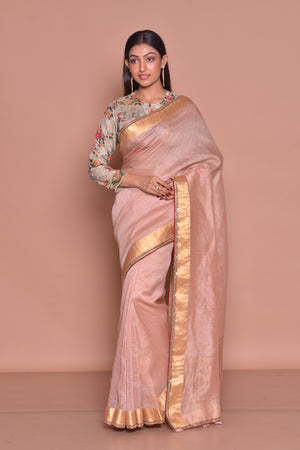 Shop elegant dusty pink saree online in USA with zari border and printed and embroidered blouse. Be occasion ready with exquisite range of designer sarees with blouse, bridal sarees from Pure Elegance Indian boutique in USA.-front