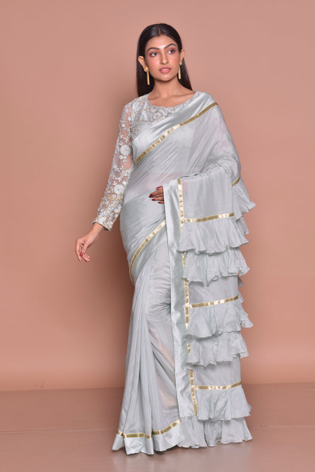 Buy light grey designer sari online in USA with frill pallu and lace saree blouse. Be occasion ready with exquisite range of designer sarees with blouse, bridal sarees from Pure Elegance Indian boutique in USA.-full view