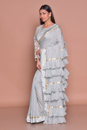 Buy light grey designer sari online in USA with frill pallu and lace saree blouse. Be occasion ready with exquisite range of designer sarees with blouse, bridal sarees from Pure Elegance Indian boutique in USA.-side