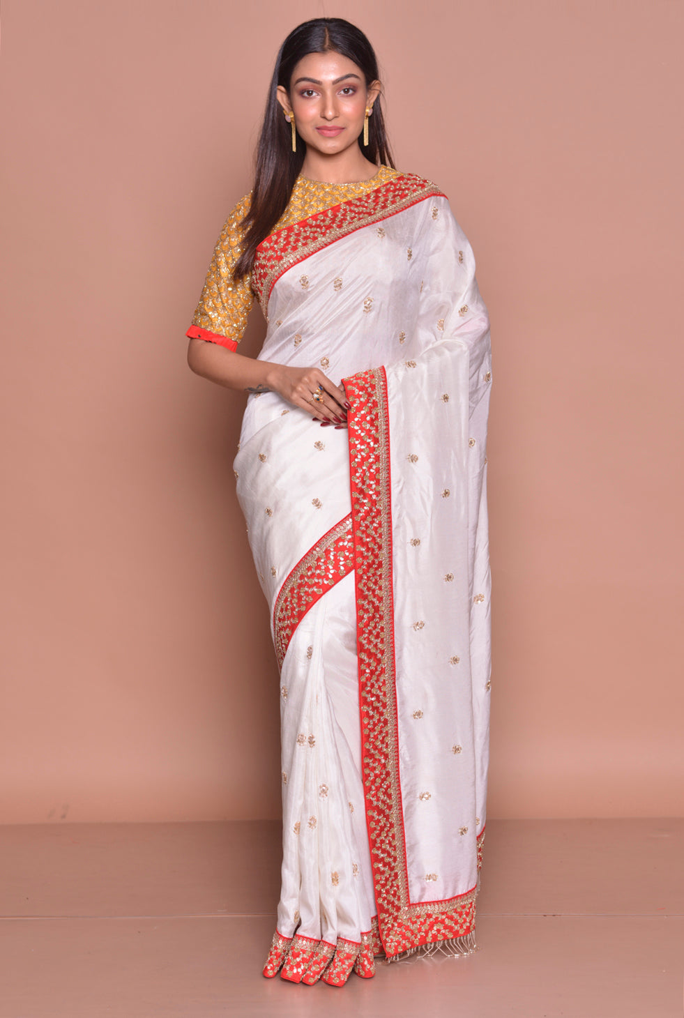 Shop stunning white embroidered muga silk saree online in USA with mustard embroidered saree blouse. Look fashionable on special occasions in contemporary sarees, designer sarees with blouse, embroidered saris from Pure Elegance Indian luxury clothing store in USA.-full view
