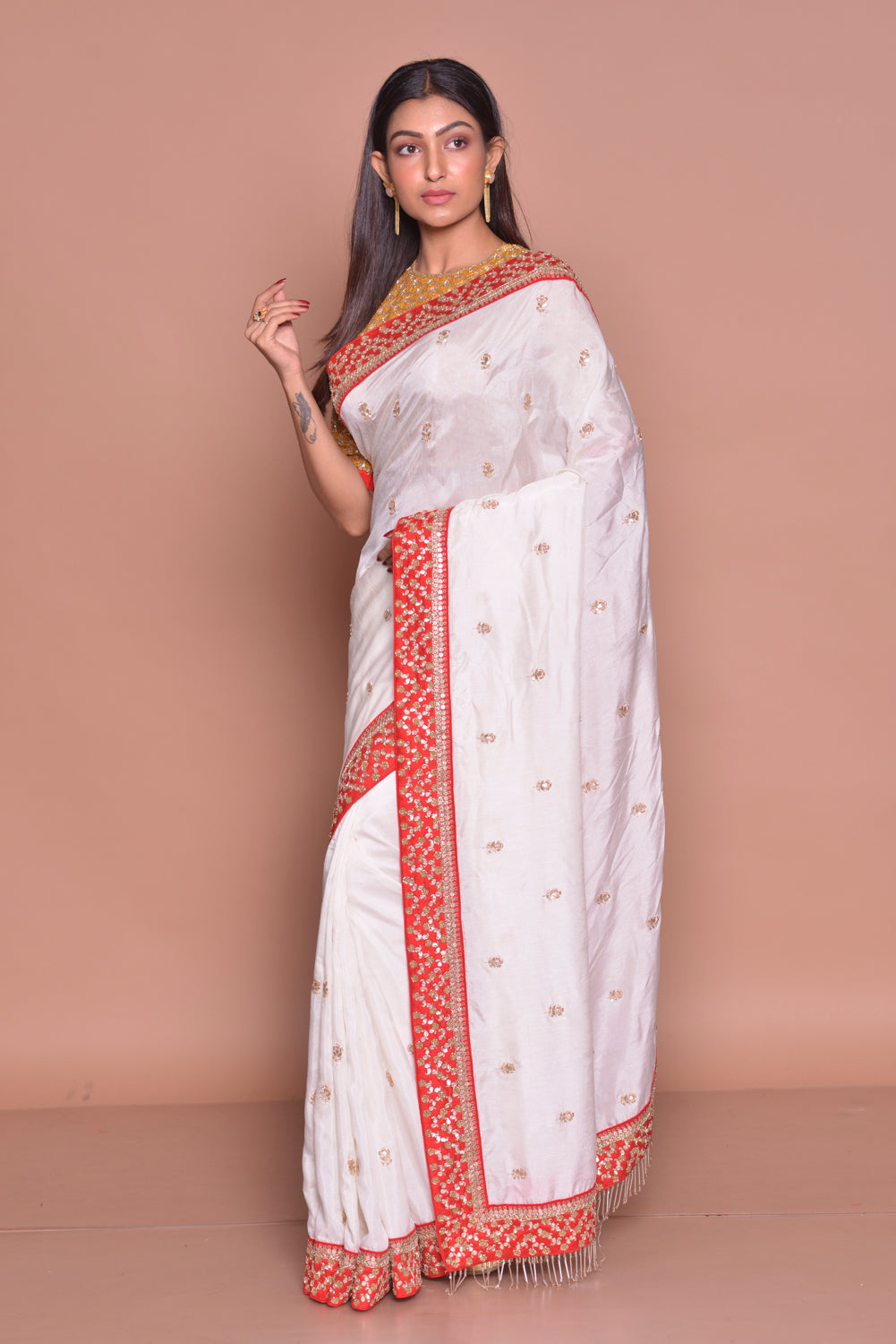 Shop stunning white embroidered muga silk saree online in USA with mustard embroidered saree blouse. Look fashionable on special occasions in contemporary sarees, designer sarees with blouse, embroidered saris from Pure Elegance Indian luxury clothing store in USA.-side